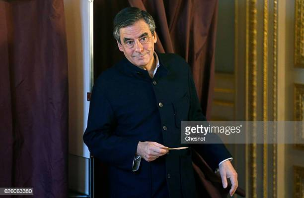 Former French Prime Minister and presidential candidate hopeful Francois Fillon walks out out the voting booth during the second round of voting in...