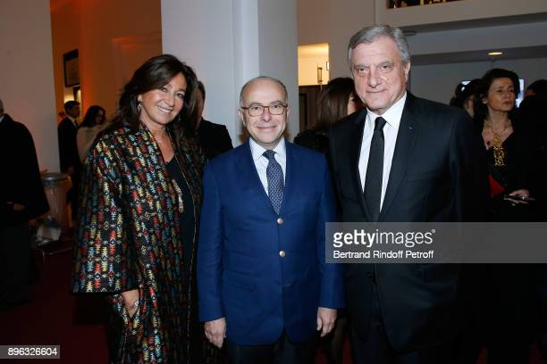 Former French Prime Minister Bernard Cazeneuve standing between CEO of Dior Sidney Toledano and his wife Katia attend the Gala evening of the...
