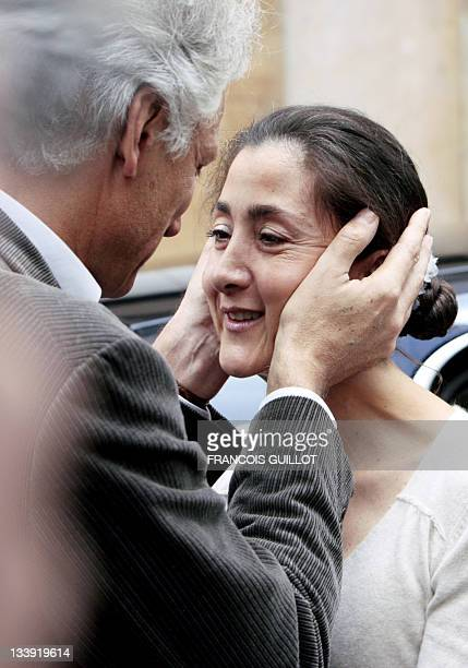 Former French prime minister Dominique De Villepin hugs former FrenchColombian hostage Ingrid Betancourt prior to have lunch on July 6 2008 at a...