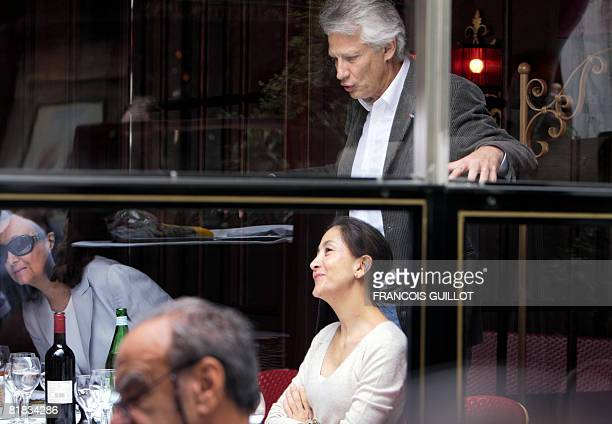 Former French prime minister Dominique De Villepin stands behind former FrenchColombian hostage Ingrid Betancourt and her mother Yolanda Pulecio...