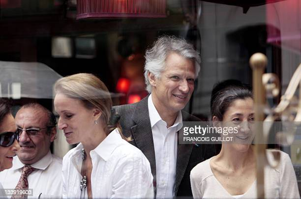 Former French prime minister Dominique De Villepin stands next to former FrenchColombian hostage Ingrid Betancourt and his wife MarieLaure during a...
