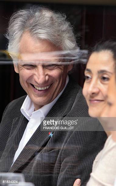 Former French prime minister Dominique De Villepin talks with former FrenchColombian hostage Ingrid Betancourt during a lunch on July 6 2008 at a...