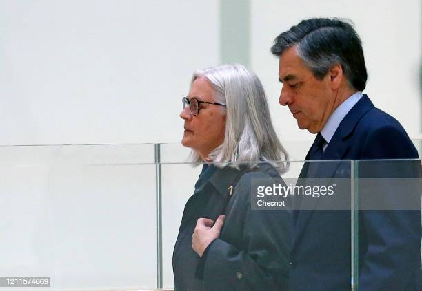 Former French Prime Minister Francois Fillon and his wife Penelope Fillon arrive for their trial at the courthouse on March 10 2020 in Paris France...