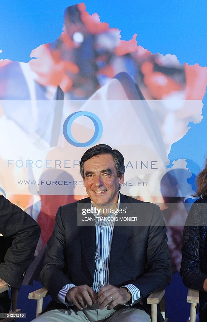 Former French Prime Minister Francois Fillon, member of a triumvirate leading the French right-wing Union for a Popular Movement (UMP) party, attends a meeting with UMP militants on August 27, 2014 in Rouez-en-Champagne, western France.