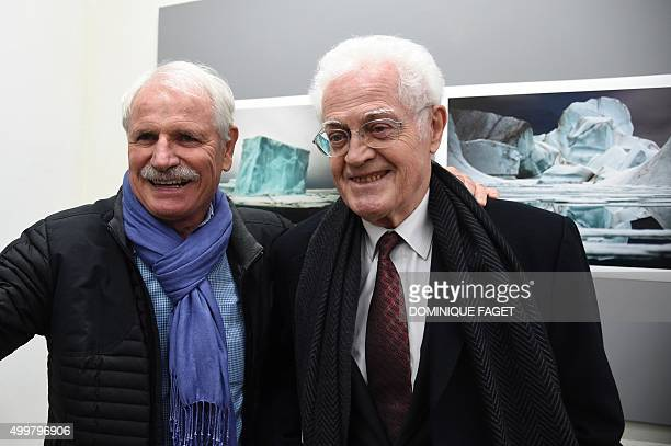 Former French Prime Minister Lionel Jospin poses with French photographer Yann ArthusBertrand during the opening of the photo exhibition 'Artica la...