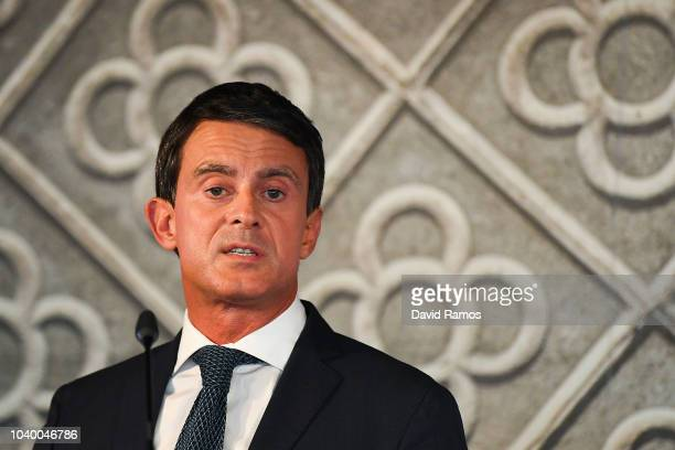Former French Prime Minister Manuel Valls shakes hands with supporters after announcing that he will run for the mayorship of Barcelona in May...