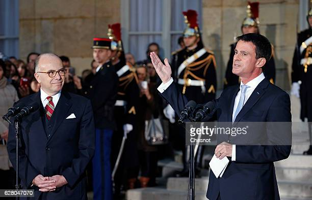 Former French prime minister Manuel Valls delivers a speech next to newly appointed Prime Minister Bernard Cazeneuve during the traditional handover...
