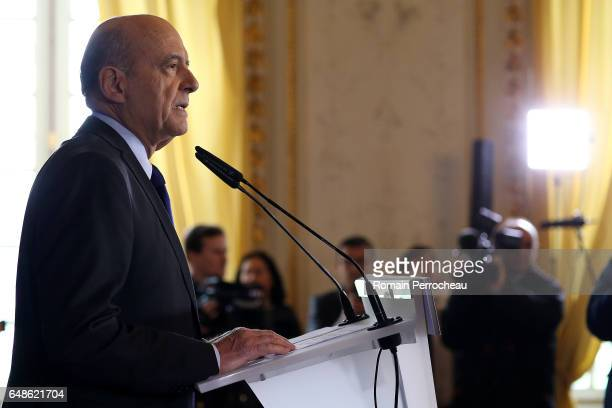 Former French prime minister member of rightwing political party 'Les Republicains' Alain Juppe delivers a speech during a press conference at the...