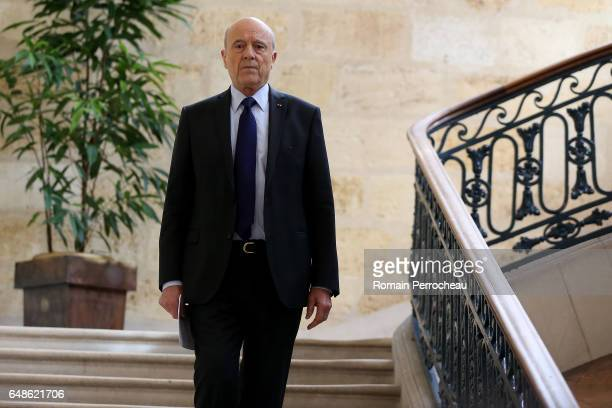 Former French prime minister member of rightwing political party 'Les Republicains' Alain Juppe arrives for a press conference at the city hall on...