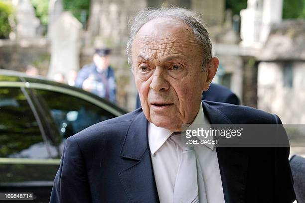 Former French Prime Minister Michel Rocard arrives to attend on June 3, 2013 at the Montmartre cemetery in Paris, the funeral of French University...