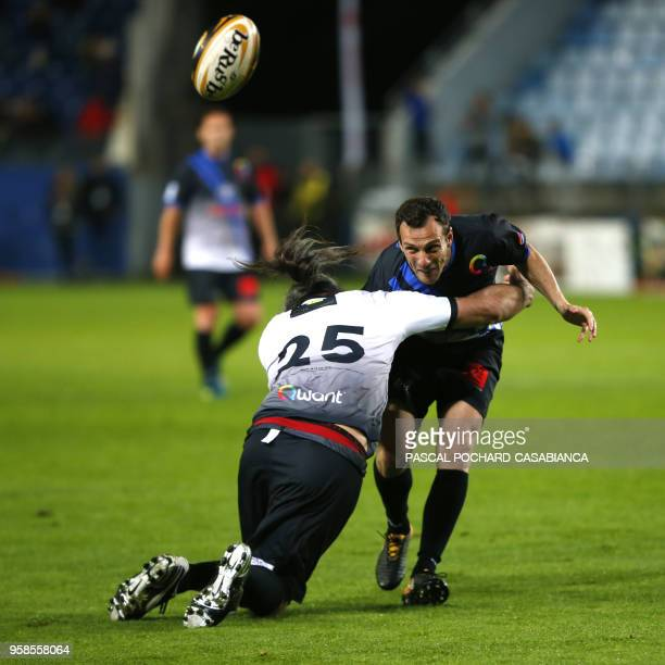 Former French rugby international Sebastien Chabal vies with Former French football international Sebastien Squillaci during the charity match...