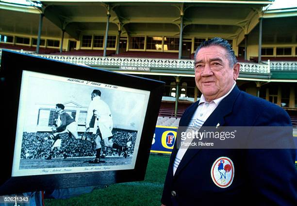 Former French rugby League player PuigAubert of his real name Aubert Puig poses in front of a large print showing him playing against Australia in...