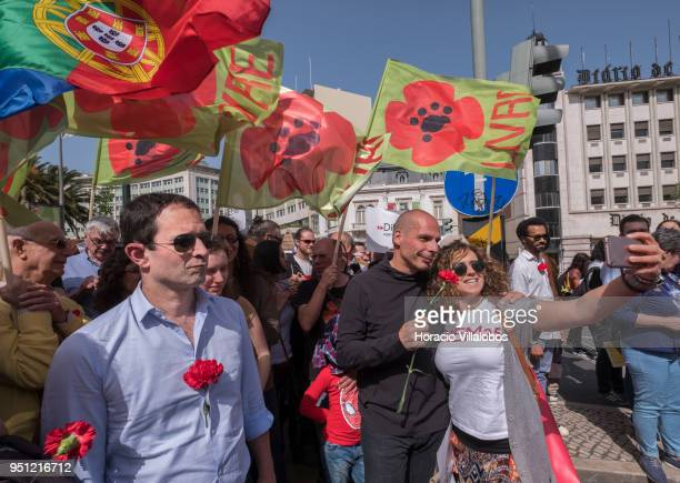 Former French Socialist Party member and founder of Générations Benoit Hamon stands near former Greek Finance Minister Yanis Varoufakis as he poses...