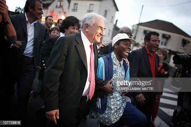 Former French Socialist Party Minister and legislative candidate Dominique StraussKahn walks in Sarcelles northern Paris after his victory over...