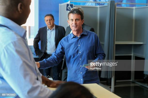 Former French Socialist Prime Minister Manuel Valls casts his ballot at a polling station at a polling station in Evry south of Paris during the...