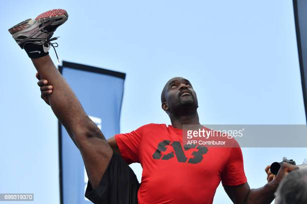 Former French taekwondo Olympic champion Pascal Gentil warms up prior to a 3X3 basketball exhibition game on the sidelines of the World Championships...