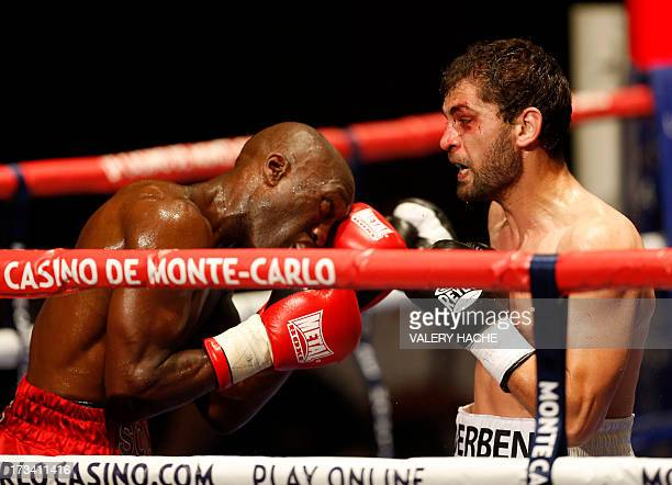 Former French WBA superlightweight champion Souleymane M'Baye fights against Russian super lightweight world title holder Khabib Allakhverdiev during...