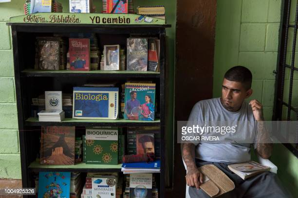 Former gang member sits next to the prison library at San Francisco Gotera jail, 161 km east of San Salvador, perform for their fellow inmates on...