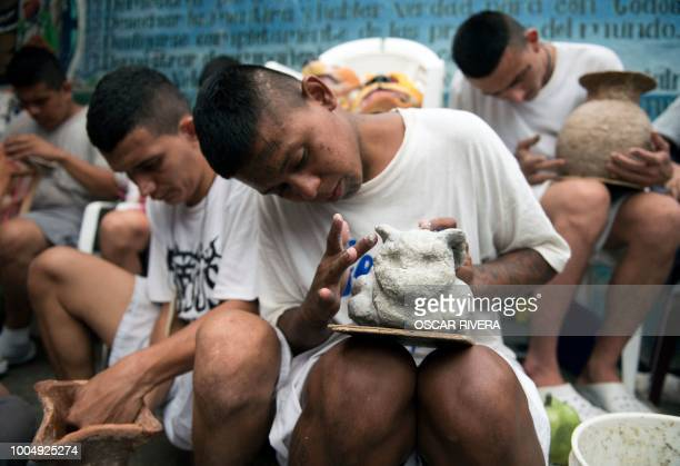 Former gang members attend a crafts and modelling class at the prison of San Francisco Gotera, 161 km east of San Salvador on July 16, 2018. -...