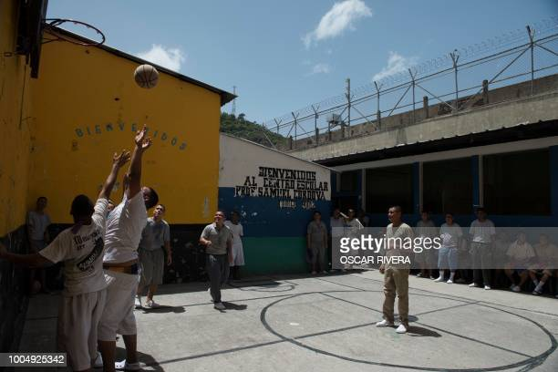 Former gang members play basketball at the prison of San Francisco Gotera, 161 km east of San Salvador on July 16, 2018. - Members of two of the...