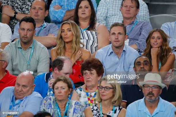Former Geelong Cats AFL footballer Jimmy Bartel, his wife Nadia Bartel, Geelong Cats captain Joel Selwood and his partner Britt Davis watch the...