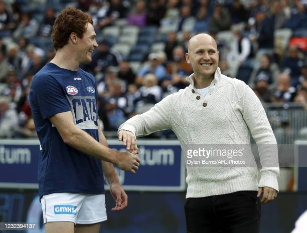 Former Geelong Cats premiership player Gary Ablett is seen with Gary Rohan of the Cats during the 2021 AFL Round 05 match between the Geelong Cats...
