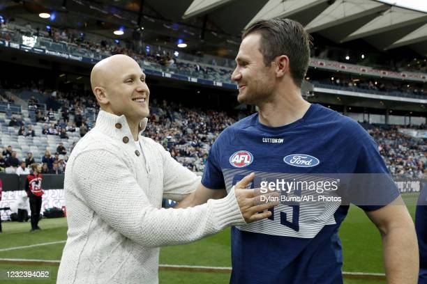 Former Geelong Cats premiership player Gary Ablett is seen with Patrick Dangerfield of the Cats during the 2021 AFL Round 05 match between the...
