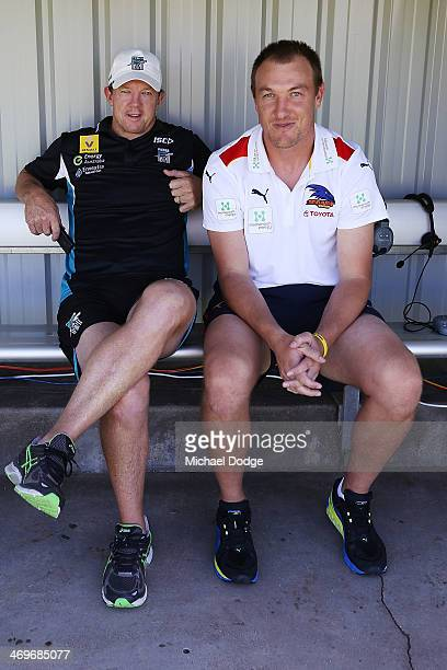 Former Geelong teamates Garry Hocking of the Power and Darren Milburn of the Crows catch up before the round two AFL NAB Challenge Cup match between...