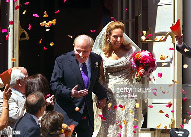 Former General Electric CEO Jack Welch descends the stairs of the Park Street Church with his new wife Suzy Wetlaufer after their one hour wedding...