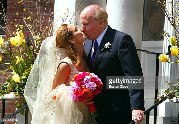 Former General Electric CEO Jack Welch gives his new bride Suzy Wetlaufer a kiss after the wedding as they arrived at their Beacon Street home for...