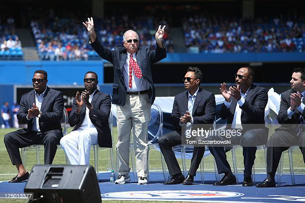 Former general manager Pat Gillick acknowledges the crowd as he is introduced during a pregame ceremony for former player Carlos Delgado of the...