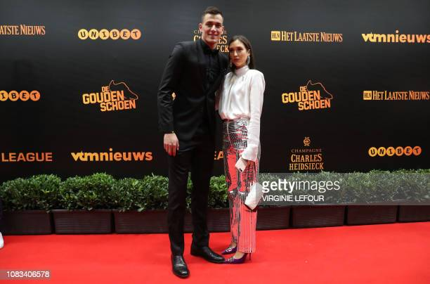 Former Gent goalkeeper Lovre Kalinic and his partner pictured on the red carpet at the arrival for the 65th edition of the 'Golden Shoe' award...