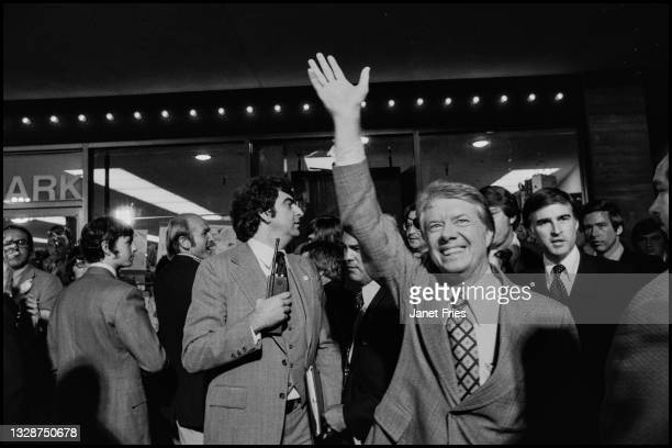 Former Georgia Governor Jimmy Carter with waves at a campaign rally in Ghirardelli Square, San Francisco, California, October 31, 1976. Among those...