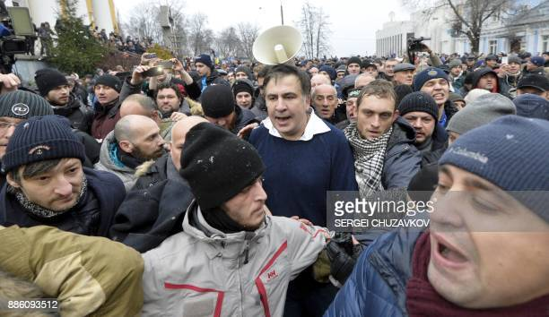 Former Georgian Mikheil Saakashvili walks after he was released by his supporters in downtown Kiev on December 5 2017 Ukrainian security services on...