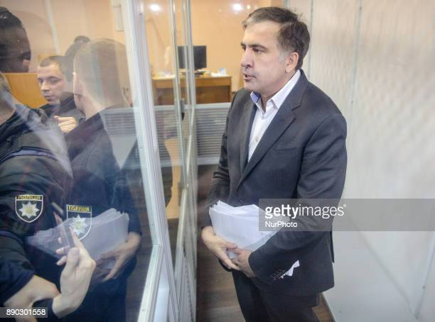 Former Georgian president and exgovernour of Odessa Mikheil Saakashvili is seen in a cage of Pechersk district court during the hearing Kyiv Ukraine...