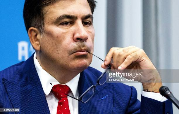 Former Georgian president and Ukrainian opposition leader Mikheil Saakashvili looks on during a press conference about his expulsion from Ukraine on...