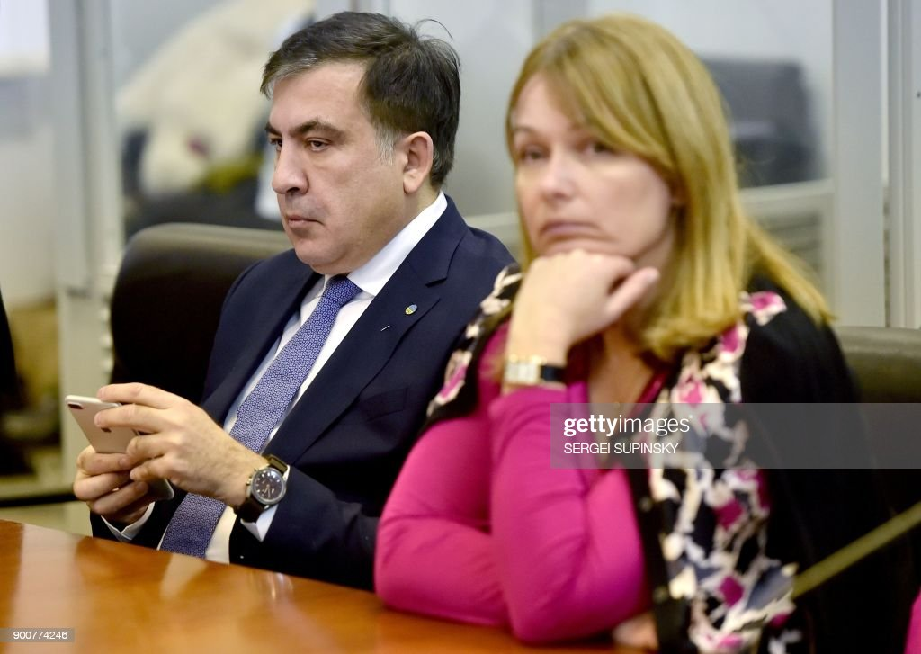 Former Georgian president Mikheil Saakashvili (L) and his wife Sandra Roelofs Saakashvili attend his appeal hearing at a courthouse in Kiev on January 3, 2018. The court, that was to consider the appeal of the prosecutor's office against the decision of the Kiev district court which released the Saakashvili from custody, postponed the hearing to January 11, 2018. / AFP PHOTO / Sergei SUPINSKY