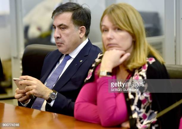Former Georgian president Mikheil Saakashvili and his wife Sandra Roelofs Saakashvili attend his appeal hearing at a courthouse in Kiev on January 3...