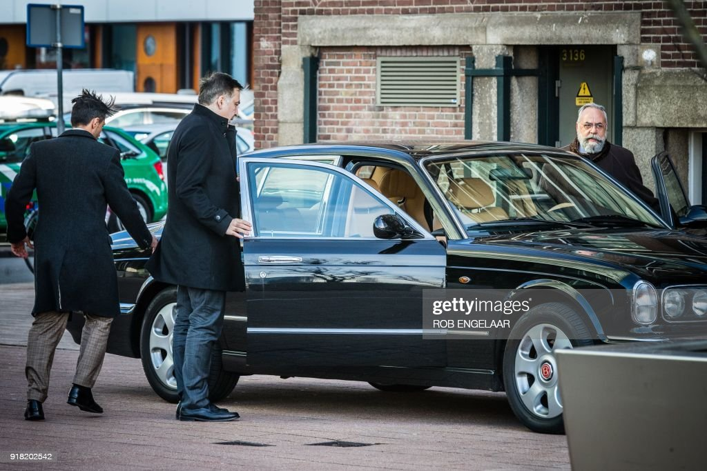 Former Georgian President Mikheil Saakashvili (2ndL) exits a car as he arrives to the Erasmus Bridge in Rotterdam, on February 14, 2018. Former Georgian president Mikheil Saakashvili arrived on February 14, 2018 in the Netherlands after being expelled by Ukraine, his lawyer told AFP. Saakashvili, who is married to a Dutch woman, 'is in the Netherlands' and 'wants to stay,' said his lawyer Oscar Hammerstein. He added that the opposition leader, who was arrested by masked men in a Kiev restaurant and deported to Poland, was sorting out a Dutch residency permit. / AFP PHOTO / ANP / Rob Engelaar / Netherlands OUT