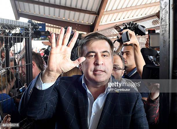 Former Georgian President Mikheil Saakashvili gestures as he speaks with journalists in a train going to Ukraine from the railway station in Przemysl...