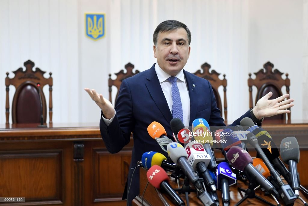 Former Georgian president Mikheil Saakashvili gestures as he speaks to the media prior to the start of his appeal hearing at a courthouse in Kiev on January 3, 2018. The court, which was to consider the appeal of the prosecutor's office against the decision of the Kiev district court to release Saakashvili from custody, postponed the hearing to January 11, 2018. / AFP PHOTO / Sergei SUPINSKY