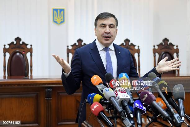 Former Georgian president Mikheil Saakashvili gestures as he speaks to the media prior to the start of his appeal hearing at a courthouse in Kiev on...