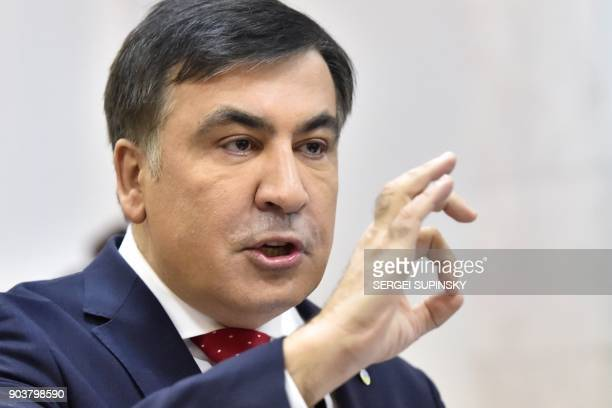 Former Georgian president Mikheil Saakashvili gestures as he speaks to the media prior the appeal hearing at a courthouse in Kiev on January 11 2018...