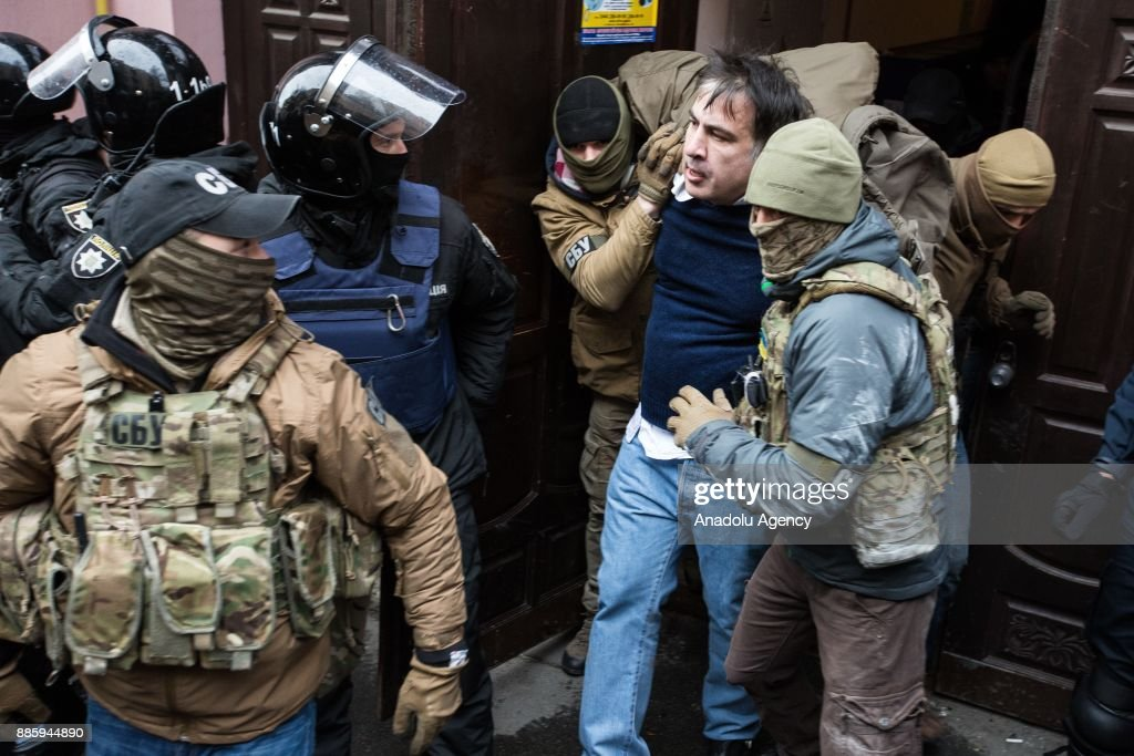 Former Georgian president Mikheil Saakashvili is taken out from his house by police officers as he is being detained in Kiev, Ukraine on December 05, 2017.