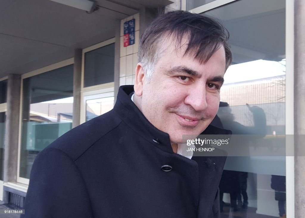 TOPSHOT - Former Georgian president Mikheil Saakashvili looks on as he stands in front of the Immigration and Naturalisation offices in Rotterdam on february 14, 2018. Former Georgian president Mikheil Saakashvili arrived on February 14, 2018 in the Netherlands after being expelled by Ukraine, his lawyer told AFP. Saakashvili, who is married to a Dutch woman, 'is in the Netherlands' and 'wants to stay,' said his lawyer Oscar Hammerstein. He added that the opposition leader, who was arrested by masked men in a Kiev restaurant and deported to Poland, was sorting out a Dutch residency permit. PHOTO / Jan HENNOP
