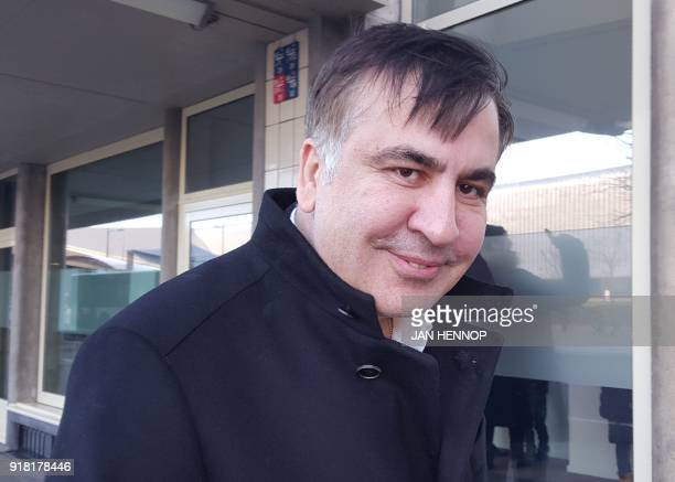 TOPSHOT Former Georgian president Mikheil Saakashvili looks on as he stands in front of the Immigration and Naturalisation offices in Rotterdam on...