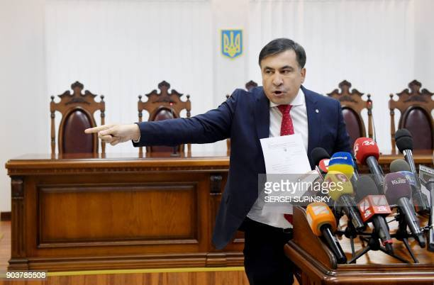 Former Georgian president Mikheil Saakashvili points with his finger when he accuses the prosecutors of corruption prior the appeal hearing at a...