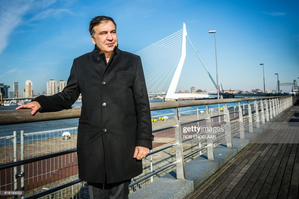 Former Georgian President Mikheil Saakashvili poses in front of the Erasmus Bridge in Rotterdam, The Netherlands on February 14, 2018. Former Georgian president Mikheil Saakashvili arrived on February 14, 2018 in the Netherlands after being expelled by Ukraine, his lawyer told AFP. Saakashvili, who is married to a Dutch woman, 'is in the Netherlands' and 'wants to stay,' said his lawyer Oscar Hammerstein. He added that the opposition leader, who was arrested by masked men in a Kiev restaurant and deported to Poland, was sorting out a Dutch residency permit. / AFP PHOTO / ANP / Rob Engelaar / Netherlands OUT