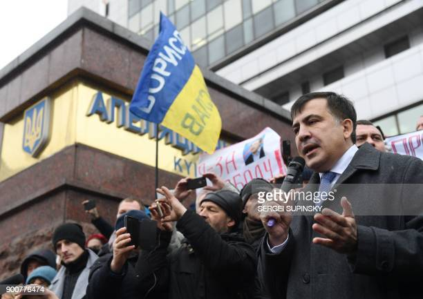 Former Georgian president Mikheil Saakashvili speaks to his supporters after attending his appeal hearing at a courthouse in Kiev on January 3 2018...