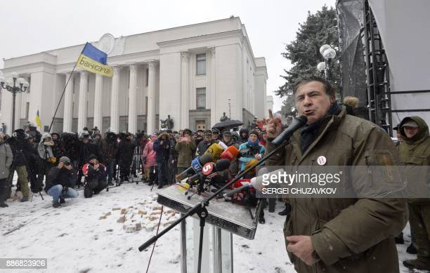 Former Georgian president Mikheil Saakashvili speaks to his supporters at a barricade in front of the Ukrainian parliament in Kiev where his...